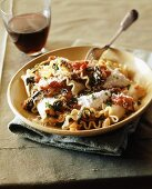 Lasagne with ricotta, tomatoes & spinach, glass of red wine