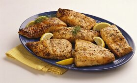 Salmon Fillet on a Platter with Lemon and Dill