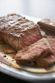 Close Up of Partially Sliced Top Sirloin Steak
