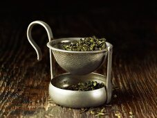 Green tea in a tea strainer