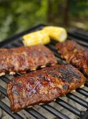 Ribs on the Grill with Barbecue Sauce and Corn