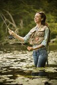 Woman Fly Fishing in River