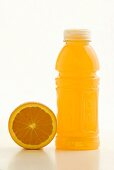 Half an Orange with a Bottle of Flavored Vitamin Water