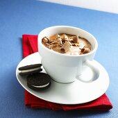 Mug of Hot Chocolate with Two Oreo Cookies