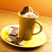 A cup of hot chocolate with chocolate ice cream and chocolate-dipped biscuits