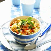 Serving of Macaroni Salad in a Blue and White Striped Bowl