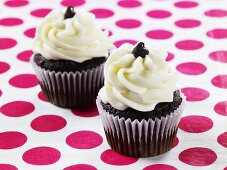 Two Red Velvet Cupcakes on Polk-a-Dot Surface