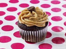 A chocolate cupcake with peanut butter cream