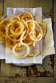 Onion Rings on a Napkin Lines Plate; From Above