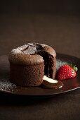 Individual Molten Chocolate Cake; Broken Open; Strawberry
