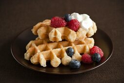 Waffles with Blueberries and Raspberries and Whipped Cream