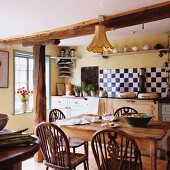 A rustic dining table and chairs in a country house