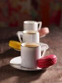 Three cups of coffee with macaroons