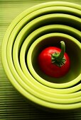 Cherry pepper in nested green bowls