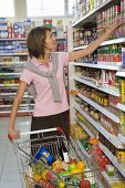 Young woman shopping in a supermarket