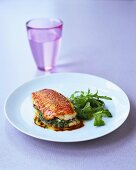Red mullet with herb stuffing and a glass of water
