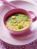 Pea and sweetcorn puree in form of ying-yang symbol