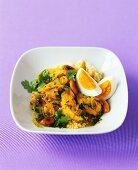 Chicken with egg and almonds on couscous (Moroccan chicken)