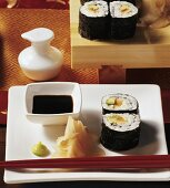 Maki-sushi with soy sauce and preserved ginger