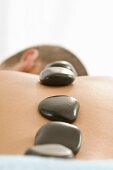Hot stone massage relaxes the back muscles