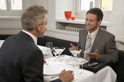 Two men at a meeting in a restaurant