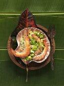 Prawns on avocado salsa in a shell