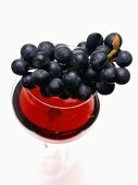 Grapes Resting on a Glass of Red Wine