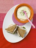 Bowl of Cauliflower Soup; Turkey Pesto Sandwich on Whole Wheat Bread