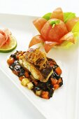 Glazed cod on a sweet-sour seaweed and vegetable ragout (Asia)