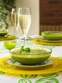 Cream of pea soup with a glass of champagne