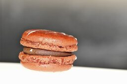 Orange macaroon with chocolate cream filling