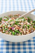 White Bean Salad with Green Beans and Onions; In Serving Bowl with Wooden Spoon
