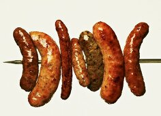 Various grilled sausages on a skewer