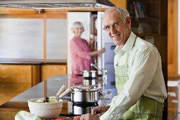 An older man cooking