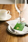 A bill and a credit card on a table