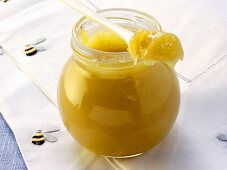 Blossom honey in jar and on spoon