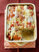 Asparagus bake with salmon and tomatoes in baking dish
