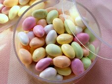 Pastel-coloured sugar eggs (jelly beans) in acrylic box