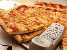 Call a pizza: Pizza margherita with telephone