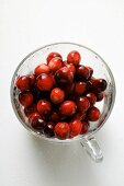 Fresh cranberries in glass (from above)