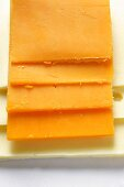 Cheese slices: Extra Sharp Cheddar on American cheese