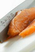 Cutting salmon for sushi