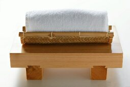 Japanese washcloth on wooden bench