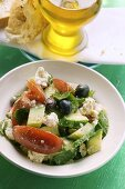 Greek salad with white bread and olive oil
