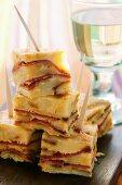Potato and pepper tortilla; white wine glass