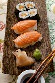 Nigiri-sushi and maki-sushi with ginger, soy sauce, wasabi