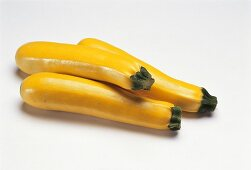 Three yellow courgettes