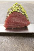 Raw tuna fillet with poppy seeds and lime zest