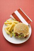 Cheeseburger, bites taken, with chips
