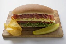 Sub sandwich with crisps and gherkin